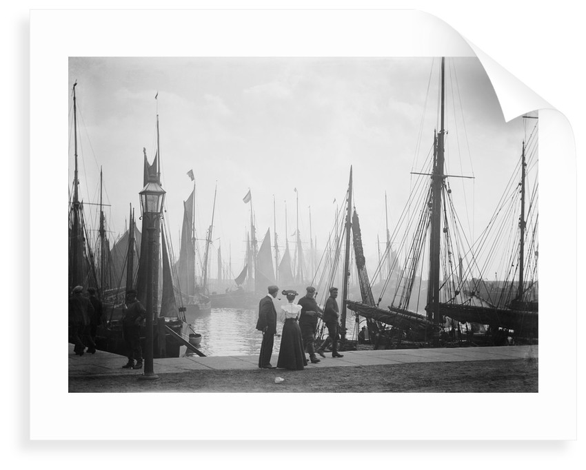 Trawlers berthed in the outer harbour with the morning mist rising at Lowestoft, Suffolk by Smiths Suitall Ltd.