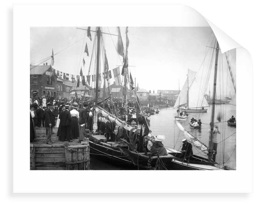 A view across Pearson's Quay along the shore of the River Colne at Rowhedge during an unidentified festival by Smiths Suitall Ltd.