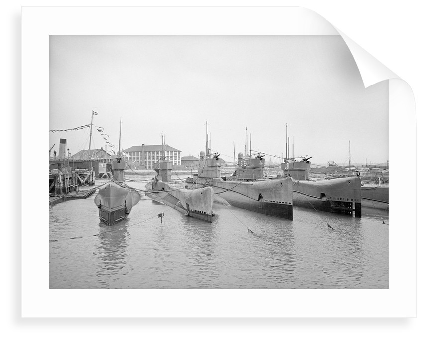 HMS Submarine 'L71' (1919), berthed at HMS 'Dolphin', Haslar Creek, with 'L56' (1919) and 'L53' (1919) inboard and 'L69' (1918) and 'L21' (1919) outboard by unknown