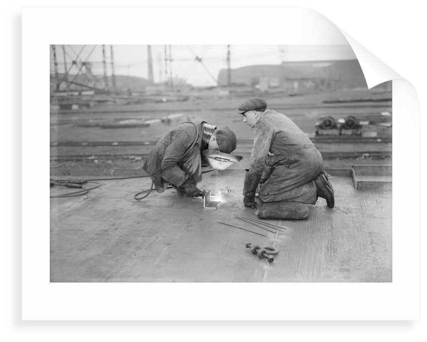 Robert the Bruce. Two welders at work aboard the vessel. by unknown