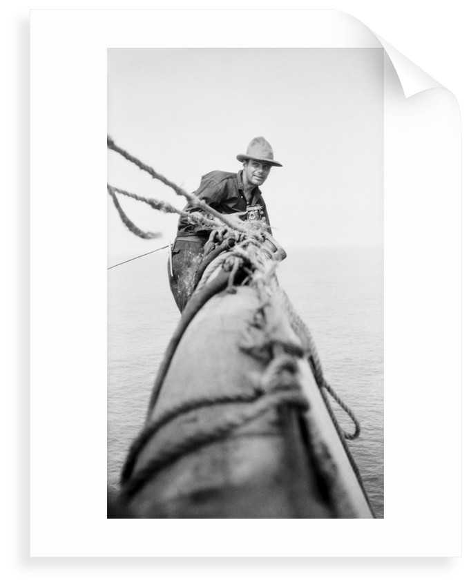 Seaman and photographer Alan Villiers on a yard with camera by unknown