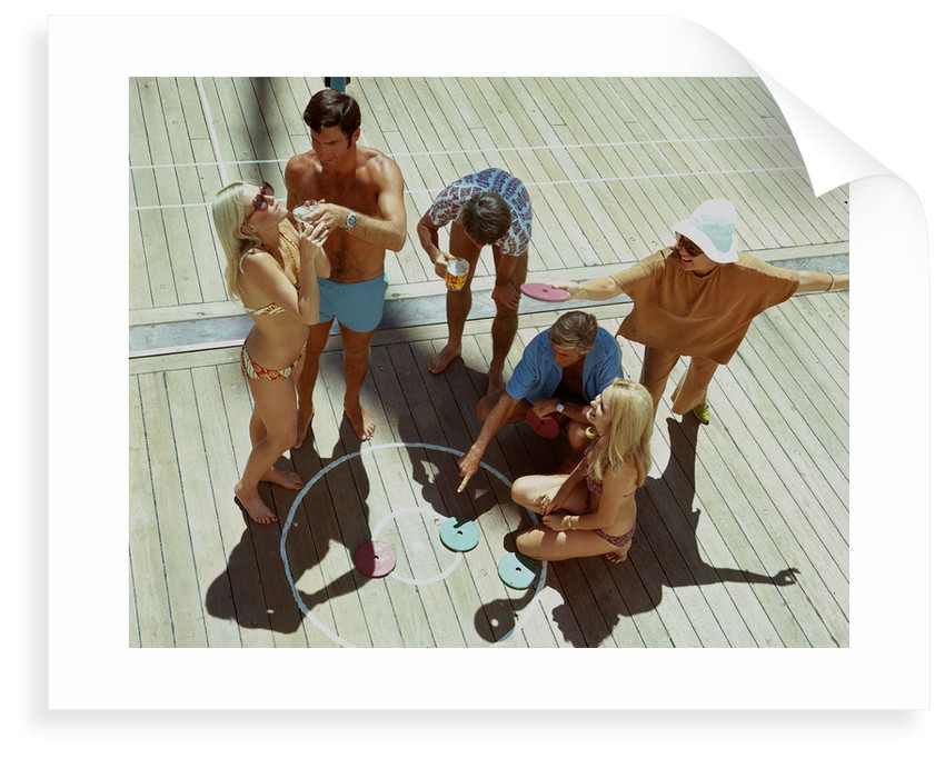 A group of passengers aboard an unspecified cruise ship enjoy a game of deck quoits by Union Castle Line Collection