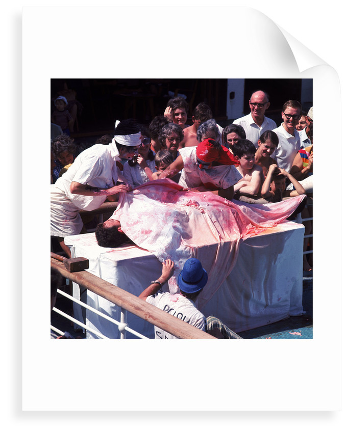 Macabre comic entertainment aboard an unspecified cruise ship - perhaps a variant of the Crossing the Line (the Equator) ceremony? by Marine Photo Service