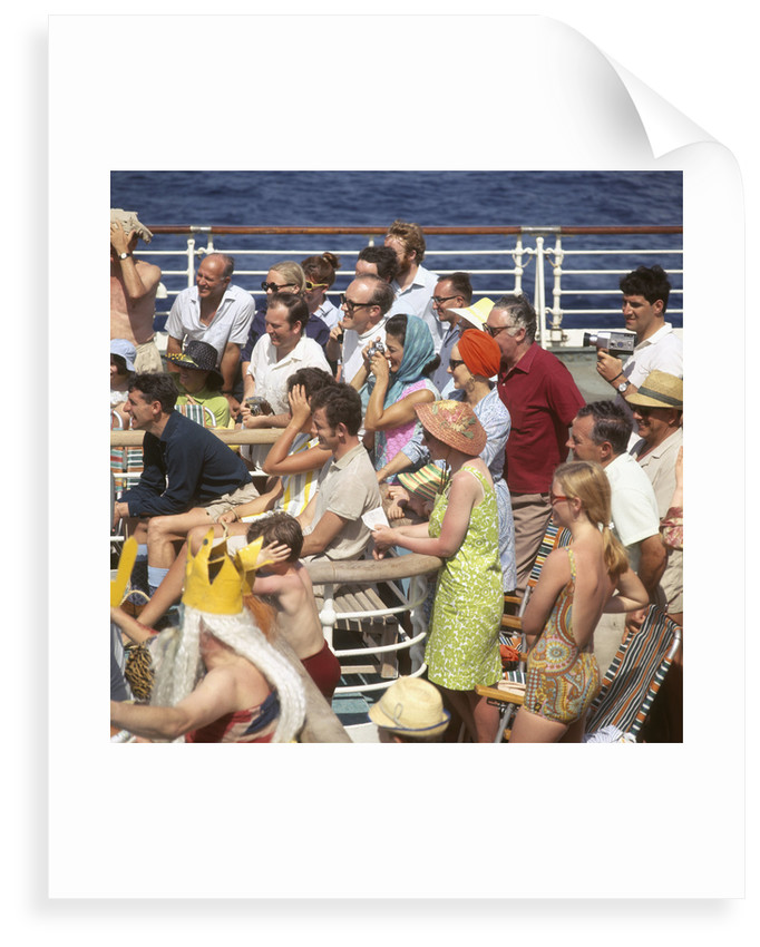 Interested passengers, young and old, enjoy on-deck entertainment aboard an unspecified cruise liner by Marine Photo Service