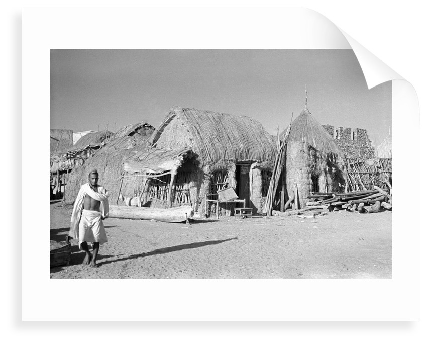 Jizan market with 'ushshah' houses by Alan Villiers