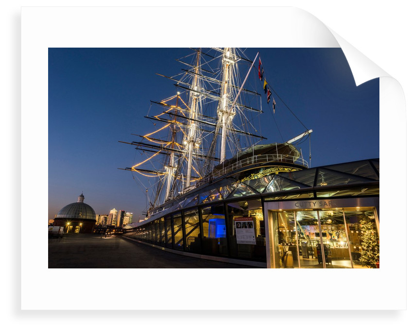 Cutty Sark port side views of the ship at sunset with Christmas tree decoration by National Maritime Museum