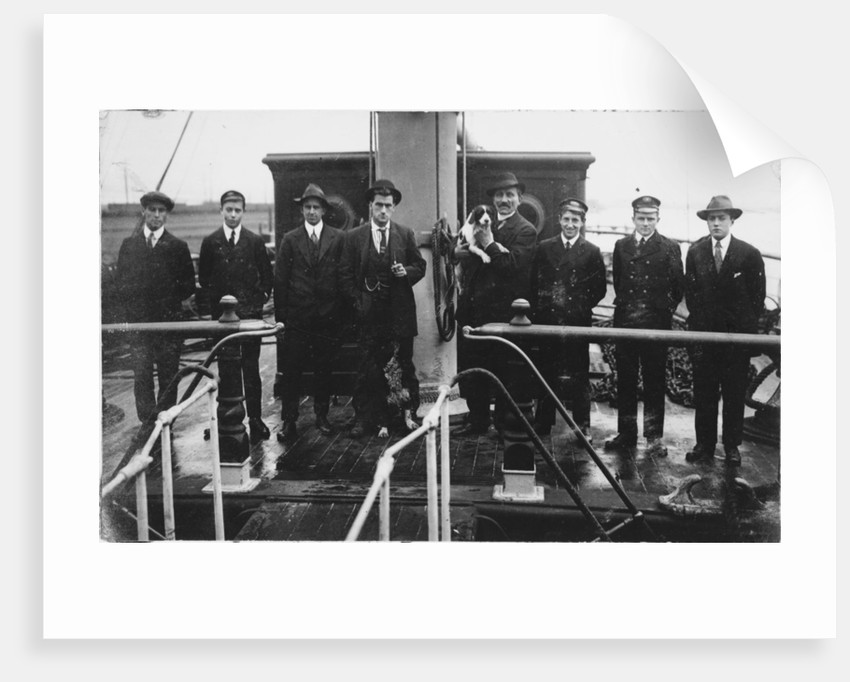 Group portrait including Captain H.J. Bray (with dog Ollie) and apprentices on deck, at Tacoma, USA by unknown