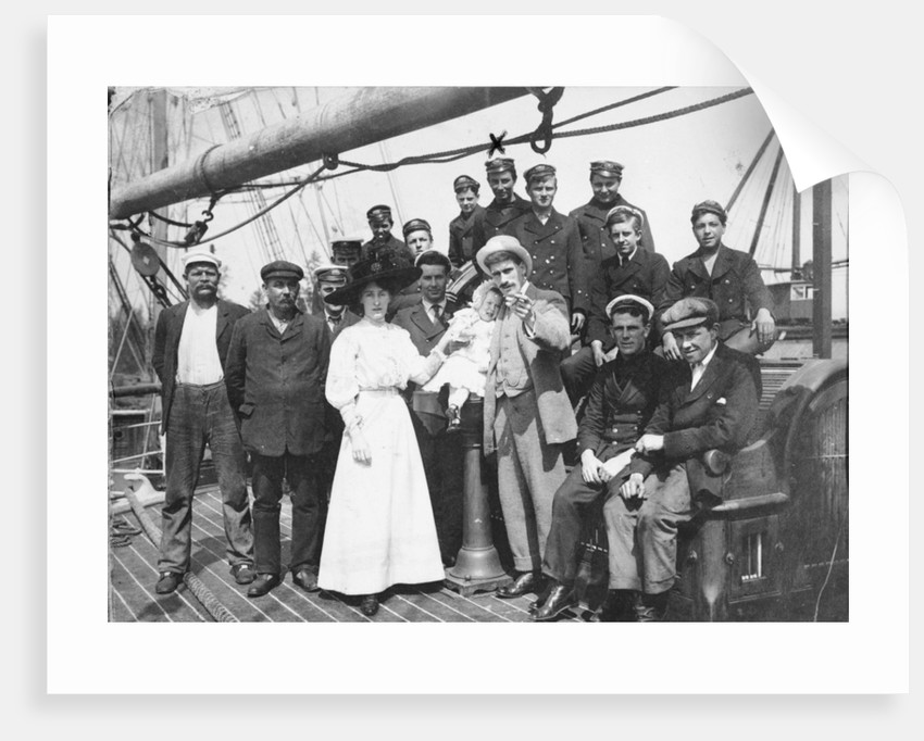 Group portrait with Captain H.J. Bray and family, also apprentices (including Owen Lloyd marked with an X) on deck, at Fraser River Mills, British Columbia, Canada by unknown