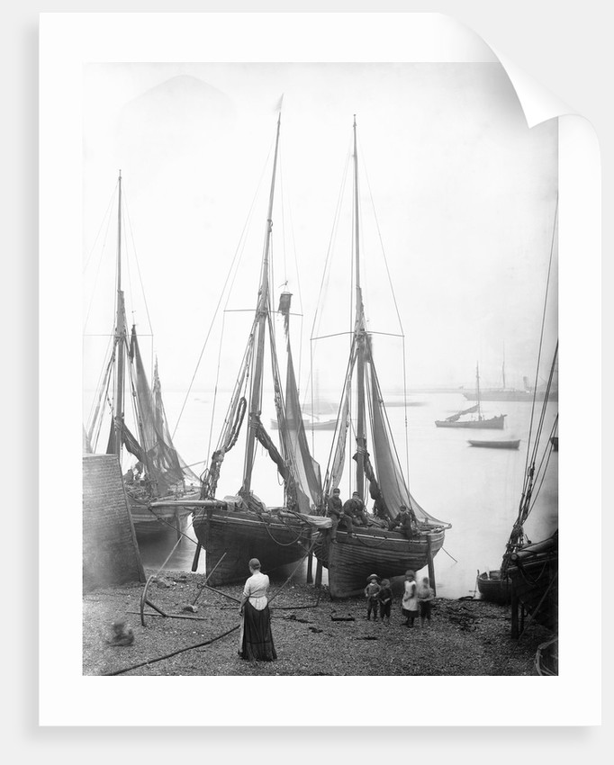View across River Thames with fishing bawleys drawn up onto the foreshore. Gravesend, Kent by unknown