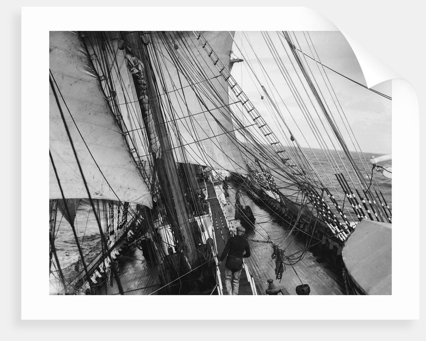 Unbending a topsail by Alan Villiers