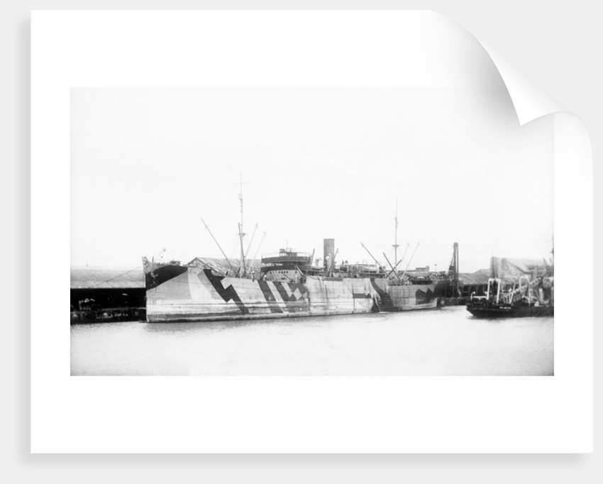 General cargo ship 'Vestalia' (Br, 1912) S. S. Co Ltd (Gow Harrison & Co), at quayside, camouflaged by unknown