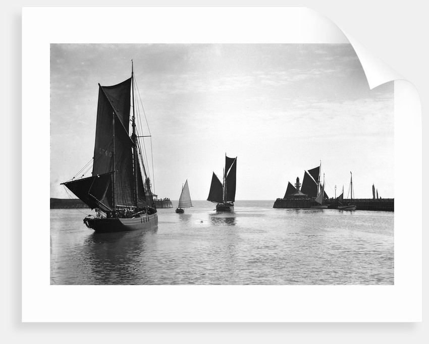 The trawler 'Roma' (1906) [LT410] with an unidentified trawler sailing out of the outer harbour at Lowestoft, Suffolk by Smiths Suitall Ltd.