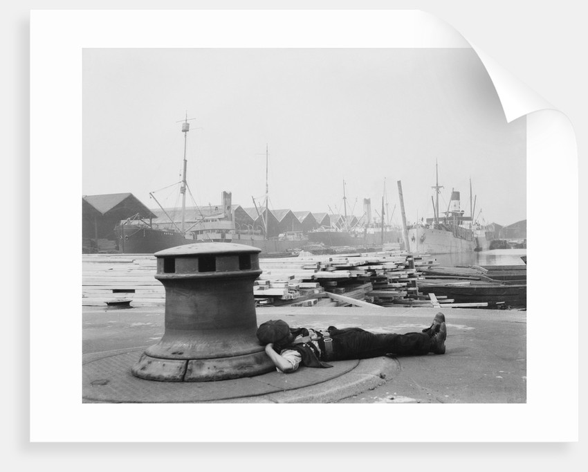 Man resting at Surrey Commercial Docks by unknown