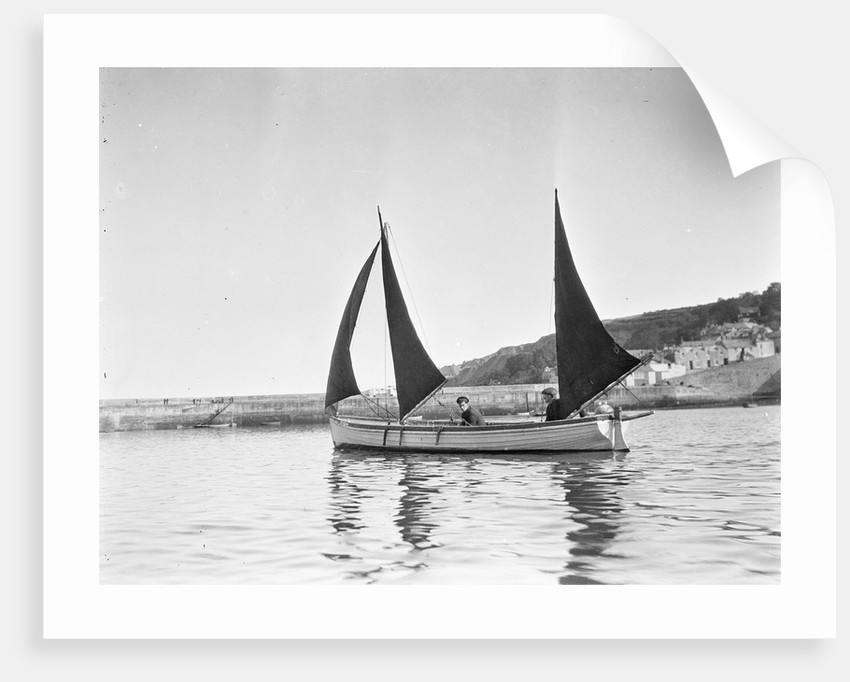 Mounts Bay pilot gig, under sail in Newlyn harbour, setting fore staysail and standing lugs with booms on fore and mizzen masts by unknown