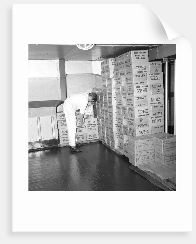 A storeroom containing boxes of Tetley's tea bags and Kellogg's Frosties, onboard 'Iberia' (1954) by Marine Photo Service