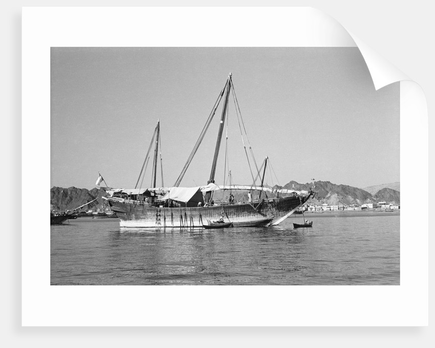 A large baggala in Mutrah harbour by Alan Villiers