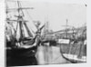 Bow view of an unidentified ship, stern of another, at low tide, Swansea by unknown