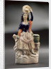 Earthenware figure of a lass by unknown