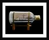 A bottle containing a model ship by unknown
