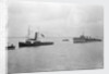 Rescue tug HMS 'Vanquisher' (1899) entering the floating dock at Harwich with the mined destroyer 'Thisbe' (1917) in tow by unknown