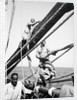 Kuwaiti sailors about their tasks on the 'Triumph of Righteousness' by Alan Villiers