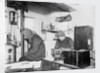 Hussey and James working in the laboratory on board 'Endurance' (1912) by unknown