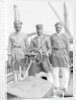 Three Lascars of the 'Viceroy of India' (1929), standing behind the wheel of one of the ship's tenders by Marine Photo Service