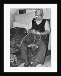 Mr L. Marling making repe mats by unknown