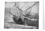 Bow view of two unidentified vessels at low tide by unknown