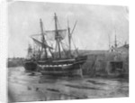 Stern quater view of copper ship and others aground at low tide by unknown