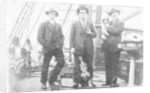 Second Officer, Captain H.J. Bray (with dog Ollie) and Chief Officer standing on deck, at Tacoma, USA by unknown