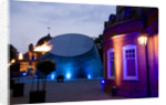 Night-time view of illuminated Royal Observatory, Greenwich, including the Peter Harrison Planetarium, Astronomy Centre (South Building) and Altazimuth Building by National Maritime Museum Photo Studio