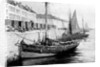 Fishing boats alongside a quay by Bedford Lemere & Co.