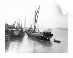The 'Olive May' (1920), a port quarter view of the barge motoring to quayside with her tender in tow (sails furled) by Anonymous