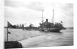 HMS 'Titania' (1915) submarine depot ship, moored at Portland with 6 submarines alongside by unknown
