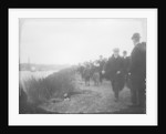 Spectators on the tow path on the south bank of the Thames near Hammersmith Bridge on Boat Race Day, 1907 by unknown