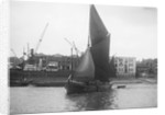 A spritsail barge under way off the Free Trade Wharves by unknown