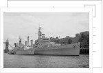 HMS 'Belfast' (1938) berthed at Symon's Wharf, Pool of London with the Dutch destroyer 'Holland' alongside by unknown