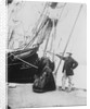 Photograph of John and Ann Gambles standing by the bow of the 'Ann Gambles' barque by unknown