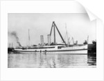 The cross channel turbine steamer 'Munich' (Br 1908) as a hospital ship at quayside, under sheerlegs by Anonymous