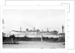 Cargo liner 'Manchester Port' (1935) under tow with topmasts struck by unknown