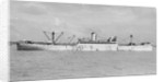 The 'Manchester Progress' (Br, 1938) under tow in port, topmasts struck by unknown