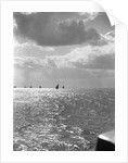 The sunlit North Sea from the harbour entrance with a number of trawlers under sail on the horizon at Lowestoft, Suffolk by Smiths Suitall Ltd.