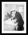 A ship's officer at the chart table of passenger liner 'Kenya' (1951) by unknown