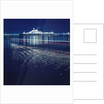 A night shot of an unspecified cruise liner under way by Marine Photo Service