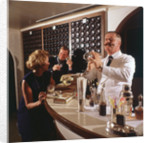 A splendidly moustachioed bartender shakes a cocktail aboard an unspecified cruise liner by Union Castle Line Collection