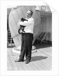 Steward with ship's cat by Marine Photo Service