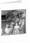 "Three children in the ""Apple Eating"" contest, possibly in the ballroom of the 'Chusan' (1950) by Marine Photo Service"