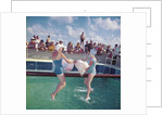 "Two ladies in swimming costumes in the ""Greasy Pole"" competition aboard the 'Empress of Canada' (1961) by Marine Photo Service"