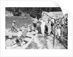 Passengers embarking into local boats from the landing stage, St Helena by Marine Photo Service